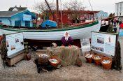 Sildebåden SAGA og Glennie Blumensaadt som fiskerkonen fra ca. 1910
